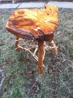 Rustic end table with a pine top and maple stick work.