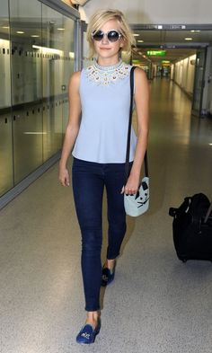 Pixie Lott At Heathrow Airport. Not sure we had the weather last week for sunnies but she sure looks fabulous!
