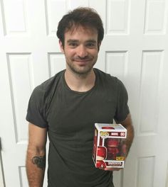 Charlie with his Pop! Funko.