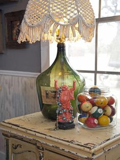 Upcycled Lamps and Lighting Ideas: A big bottle of vino was emptied then turned into a table lamp. The unique macramé shade adds the perfect touch of fun chic.  From DIYnetwork.com