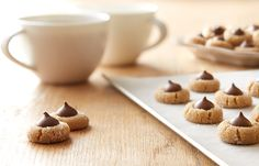 Try this Tiny MINI KISSES Peanut Butter Blossoms recipe, made with HERSHEY'S products. Enjoyable baking recipes from HERSHEY'S Kitchens. Bake today.