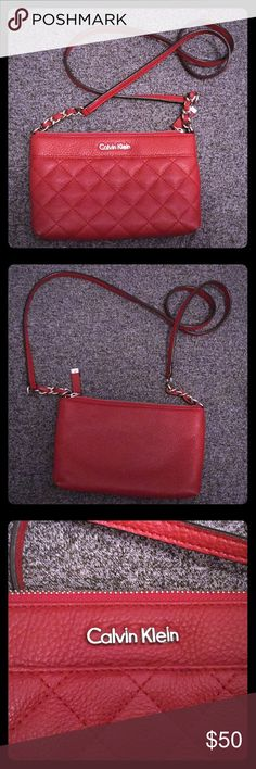 "Calvin Klein red leather crossbody bag EUC A red crossbody bag, perfect size to take with you for dinner, out for the night, or even walking around. I can comfortably fit my wallet, and phone in it. I love to wear it to add a pop of color to an outfit, or just to accent an outfit.  There are some small stained spots on the inside of the bag.  8.75"" length 5.5"" height 1"" width  Open to reasonable offers. Bundle discount available. :) Calvin Klein Bags Crossbody Bags"