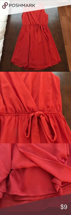 """NWOT Red Wrap Style Dress Beautiful red dress with elastic waistband and peephole in the back. Very flattering fit for all chest sizes. Only worn once. Fully lined. Medium is like a junior's size. Dress fits above the knee on 5'4"""" woman. Monteau Dresses Mini"""