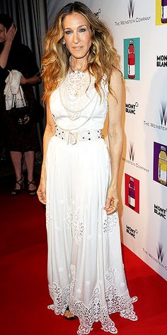 SARAH JESSICA PARKER As the latest star to wear a piece from Dolce & Gabbana's star-loved white dress collection, the style icon gives it her own spin with a sparkling belt and layered Lanvin pearls at a Weinstein Company and Vitaminwater event.