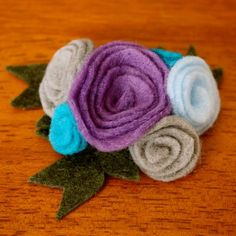 """From headbands to hair clips to bouquets FELT FLOWERS are all the rage. In preparation for an upcoming baby shower (details to come…get excited!) I've been looking for an easy felt flower tutorial. Actually, all I really needed was a """"how to hand cut a flower out of felt that doesn't look like an octopus or …"""