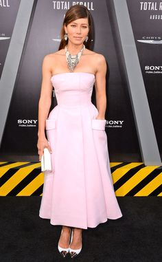The leading lady is pretty in pink in a strapless Dior couture gown with a voluminous skirt at the Los Angeles premiere of Total Recall.