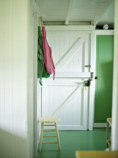 vacation cottage. cool door. painted floors perfect choice for a home by the beach.