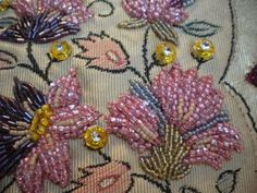 Bead embroidery added to a piece of silk from a vintage Kimono Obi (sash).: