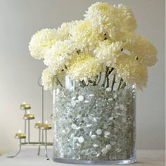 White flowers in majestic glass vase, clear river rocks, stones, tealight candles, beautiful and classic centerpiece - shop online @ www.partylite.biz/nikkihendrix/productcatalog?page=productdetail&search=true&sku=P91166