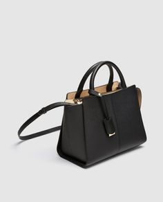 Pendant detail on the handle in contrasting colours. Unique Handbags, Stylish Handbags, Tote Handbags, Purses And Handbags, Designer Crossbody Bags, Shopper, Handbag Accessories, Leather Crossbody Bag, Fashion Bags