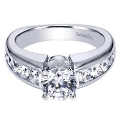 A glorious diamond encrusted band and crown create the perfect setting for this diamond engagement ring. Give your loved one a ring fit for a princess: the 14K White Gold Contemporary Cathedral Engagement Ring.  $4347.00 mounting only.