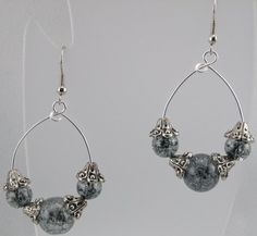 Gray crackled glass beads with silver tone bead caps on silver tone wire Silver tone fish hook ear wires