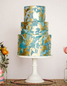 Edible gold leaf is going to be huge this year.  I love the colours and antiqued effect on this cake.