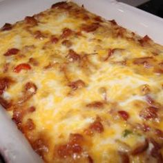 Bacon Breakfast Casserole.  I would like to try making this low carb by substituting cauliflower for the tater tots.  And switch the 2 cups of milk for  almond milk and half & half or something.