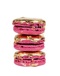 "Ladurée and Nina Ricci: the limited edition ""La Tentation de Nina"": delicious pink macarons with gold leaf, filled with raspberry cream"