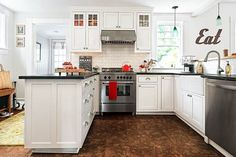 Lots of light, cork tile floor that's friendly on the back, natural soapstone countertops and Shaker-style cabinets make this kitchen a classic sure to stand the test of fickle trends and time. | Photo: Susan Teare | thisoldhouse.com