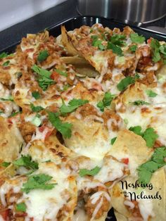 Turkey Chili Nachos by Noshing with the Nolands. The perfect game day appetizer or snack any time of the year.