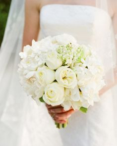 White Bo <8 of 28 > White Bouquet  Gardenias, stephanotis, lily of the valley, polo roses, and peonies are arranged in small groupings for a bouquet that mixes elegance and a contemporary vibe.uquet
