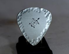 Hammered steling silver sea turtle guitar pick