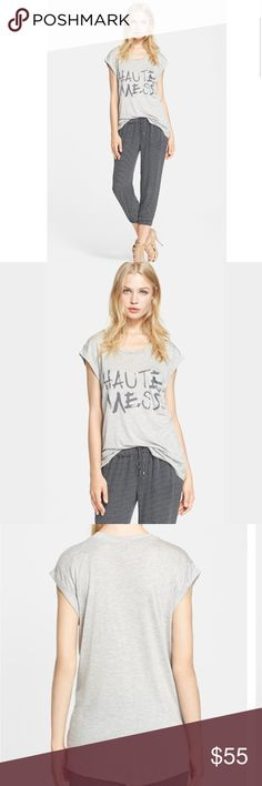 Haute Hippie Tee A clever statement fronts a supersoft, oversized tee styled with a scooped neck, rolled short sleeves and a slouchy chest pocket. 100% modal. Dry clean. Haute Hippie Tops
