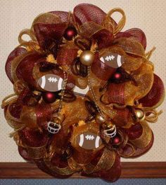 WREATH DECO MESH BURGUNDY & GOLD SPORTS FOOTBALL WREATH 30 IN.