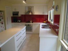 White Kitchen Red Splashback red splashback white cabinets silver appliances and wooden floor