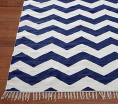 I love the Chevron Rug on potterybarnkids.com! Perfect floor accent with the navy win panels we got!