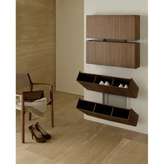 Functional shoe-rack designed by Colzani is what makes of Pit Stop a must have. This wall mounted shoe-rack is in canaletta walnut, but the front elements are also available covered in cuoietto or smocked mirror.