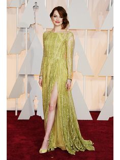 emma-stone-oscars-2015-academy-awards. Something about this colour I like. Pretty with the lipstick. The photos where it looks like Dijon mustard are a dial tone compared to those where the colour is reaching for clear, vibrant chartreuse. She could wear reflector stripe yellow-green and probably look radiant.