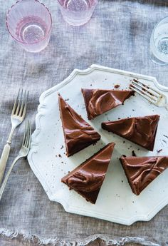 Samantha Seneviratne shares a magical moist chocolate cake that's baked with coconut oil from her new cookbook Sugar & Spice. Top it with the rich chocolate taste of a classic chocolate ganache. #COTD