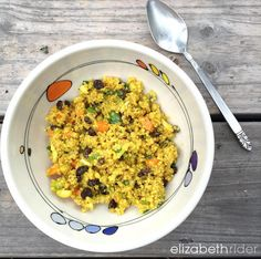 Elizabeth's Curry Quinoa Salad Recipe uses quinoa instead of couscous to up the protein, fiber and all around nutrition. Plus, it's delicious! www.elizabethrider.com