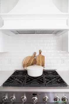 Gorgeous white kitchen with white subway tile backsplash. White oven hood over a gas stove. Loving our new kitchen renovation! Home Decor Kitchen, Favorite Kitchen, Oven Hood, Coastal Kitchen, Brick Backsplash, Kitchen Accessories, White Subway Tile Backsplash, Kitchen Tiles Backsplash, Gorgeous White Kitchen