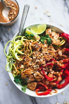 Thai Peanut Chicken And Zucchini Noodle Bowl https://www.changeinseconds.com/thai-peanut-chicken-and-zucchini-noodle-bowl/