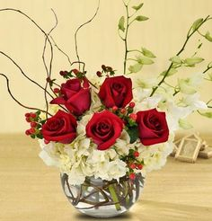 """""""Carithers Manhattan Magic"""".  Christmas Flowers, Centerpieces, Holiday Gifts, Carithers Flowers.  Delicate white orchids, red roses, and white full-bloom hydrangea.  http://www.carithers.com/christmas/Flowers-Centerpiece-Class-Orchids"""