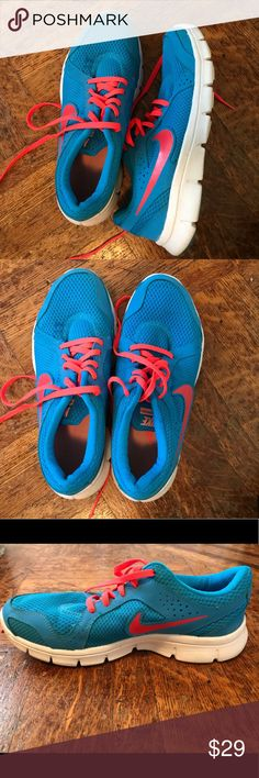 Nike Running Shoes Turn heads while you're on a run with these electric blue and hot pink running shoes! They are super comfortable and super light to make running a breeze. Only been worn a handful of times. In great condition!! Nike Shoes Athletic Shoes