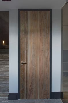 Floor to ceiling wooden door, cool frame.