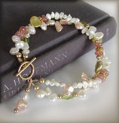 Multi strand Keishi Pearl bracelet with Peridot, Rohodochrosite and 14k Gold Filled accents. This designs features a huge variety of Keishi