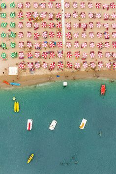 An aerial photo of beach umbrella overload in Italy