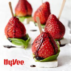 Strawberries and balsamic are such a classic combo. Make them into an easy-to-eat appetizer by serving on a piece of brie with a basil leaf.