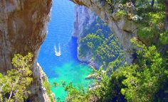 26 Must-See places in Italy.  This natural arch is at the end of the Isle of Capri, Italy. It's a relaxing and beautiful viewpoint far from the crowds of the towns, and well worth the walk.