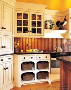 The backsplash looks like real beadboard.  I like the contrast with the painted cabinets..  Victorian Kitchen Cabinets #35 (Crown-Point.com, Kitchen-Design-Ideas.org)