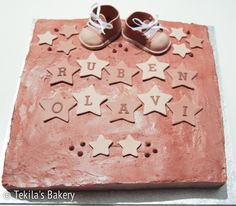 Chocolate mousse cake with brown baby shoes and stars
