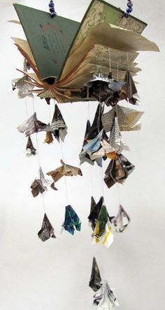 Origami paper art ireally like the mobile look of this book. It kind of looks like of birds are falling from the the pages. I think this would be an interesting piece to make. Book Crafts, Arts And Crafts, Paper Crafts, Diy Paper, Origami Paper Art, Altered Book Art, Recycled Books, Book Sculpture, Paper Sculptures