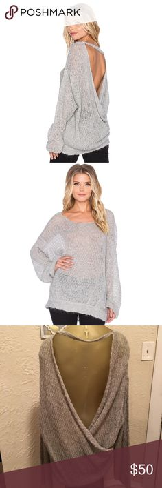 Free People open back draped sweater Loose knit open draped back sweater. Super cute and cozy. Heather Gray. Never worn. New with tags. Free People Sweaters