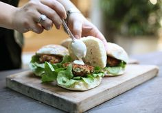 Plating up my garlic prawn burgers. Recipe out in Sept 2013. Photos by Sophie McComas, credit to Sophie McComas too