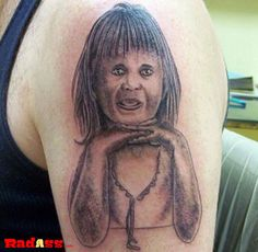 This is proof that i will never get a tribute tattoo with a person's portrait. They rarely work out properly.