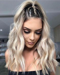 We #❤️ this hairstyle that you can rock at a beach party or summer festival. We will see a lot of braided half up this summer. #hairbraid #summerhair #hair #fashion #festivalhair #chilham hair.