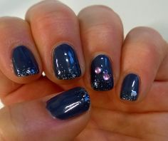 A simple manicure with shimmer on the tips of the nails and a few rhinestones