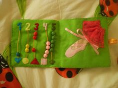 Triinu tuhat toimetust: tegelusraamat/ quiet book: shapes and numbers page; tying ballet slipper laces page