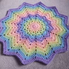 Sherilyn Haycox to CROCHET ADDICT 11 hrs · 1st blanket order of 2018 is underway. These pastel shades go together so well. This completes 2 full rounds of the colour sequence. Pattern: Round ripple baby blanket by celeste young (Ravelry) Yarn: Stylecraft special dk in candyfloss, apricot, lemon, spring green, cloud blue and wisteria.